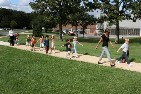 School Kids Walking on Sidewalk